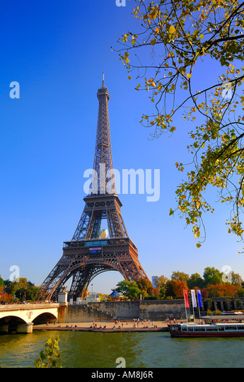 View of The Eiffel Tower, beside the River Seine, in Paris France, symbol of Paris - Stock Image