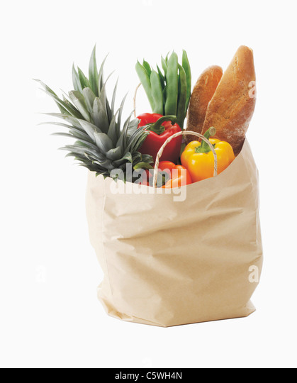 Shopping bag with healthy foods against white background - Stock Image
