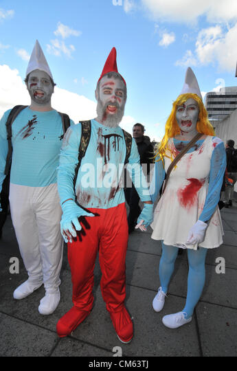 Southbank, London, UK. 13th October 2012. Three 'Zombie' Smurfs on the Southbank. World Zombie Day, a Zombie - Stock Image