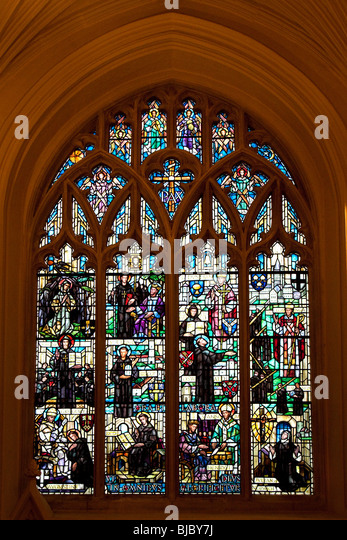 Stained glass window in Norwich Cathedral in Norfolk in South East England - Stock Image