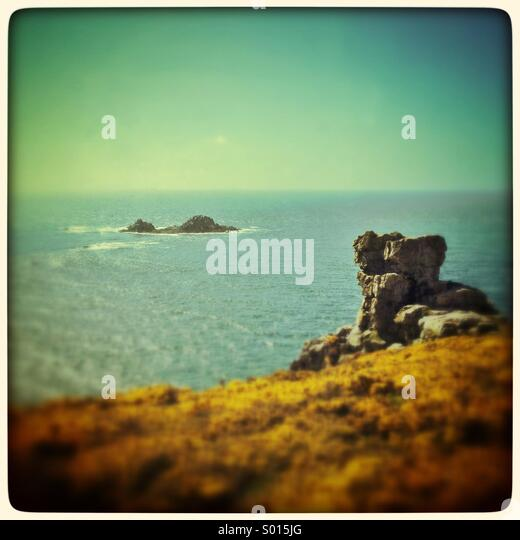 Rocks on the Cornish coastal cliff path - Stock Image