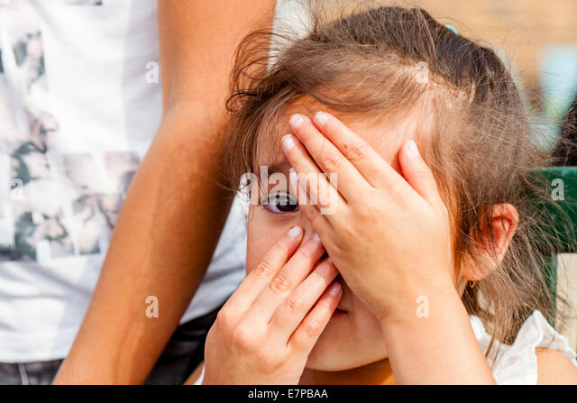 Shy Child, Hartfield Village Fete, Sussex, England - Stock Image
