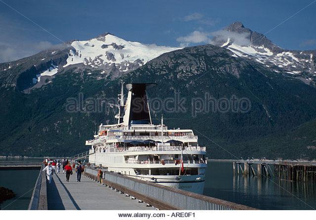 Alaska Skagway cruise ship boat city dock Mt. Harding Glacier beyond - Stock Image