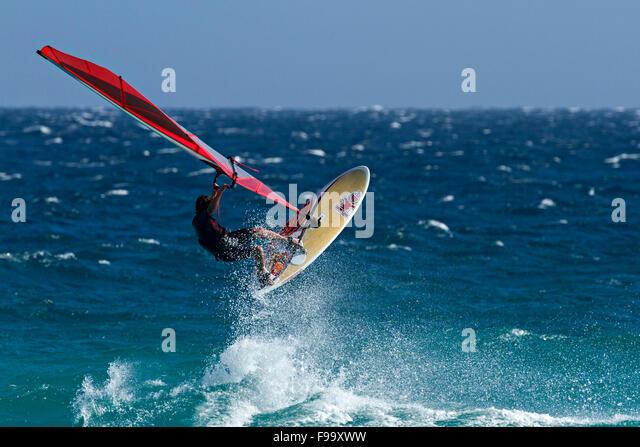 Wind Surfer wave jumping, Esperance, Western Australia. - Stock Image