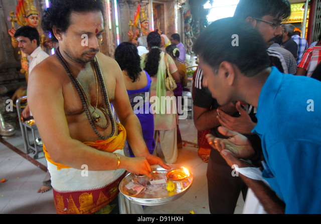 Singapore Little India Serangoon Road Sri Veeramakaliamman Temple Hindu Tamil Asian man pujari archaka priest ritual - Stock Image
