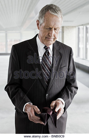 Businessman with empty wallet - Stock Image
