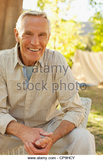 80 plus years,aging,california,casual clothing,caucasian,color image,confidence,day,focus on foreground,front view,hands - Stock Image
