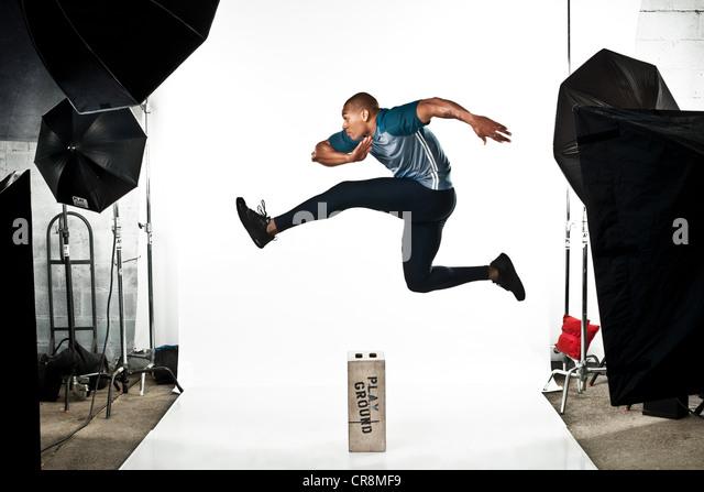Athlete at photo shoot, jumping - Stock Image