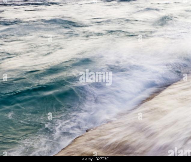 Blurred motion shot of ocean waves - Stock Image