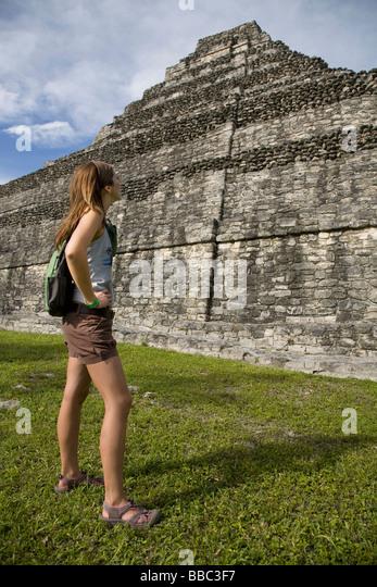 Woman Looking at Mayan Ruin - Stock Image