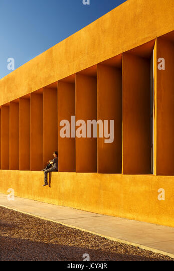Facade perspective with seating figure. Laayoune Technology School, Laayoune, Morocco. Architect: Saad El Kabbaj, - Stock-Bilder