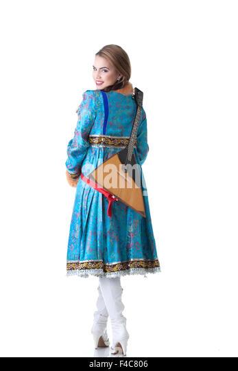 Cheerful Russian girl posing with balalaika - Stock Image