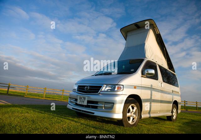 Mazda Bongo Camper Van with roof elevated, Devon, England. Summer 2009. - Stock Image