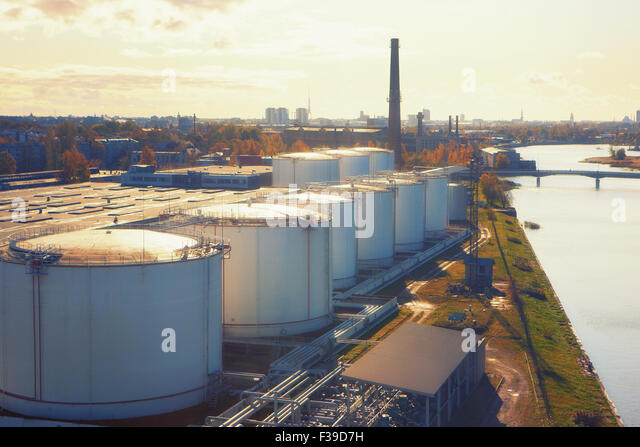 Latvia, Riga. View of the city of Riga from the port warehouses near the river and tube on a sunny day - Stock Image