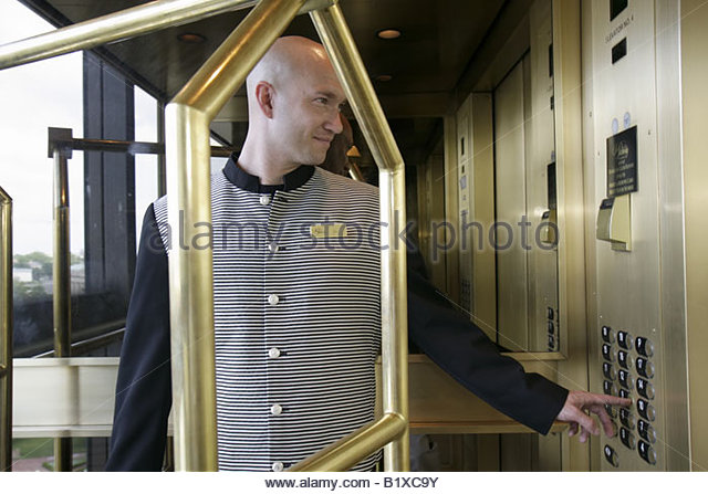 Little Rock Arkansas The Peabody Little Rock hotel bellman elevator luggage cart man uniform bellhop job hospitality - Stock Image