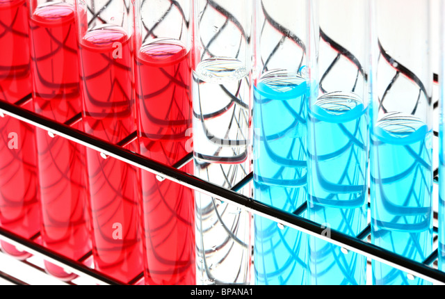Chemicals in test-tubes. Liquid chemicals in a chemical laboratory. - Stock Image