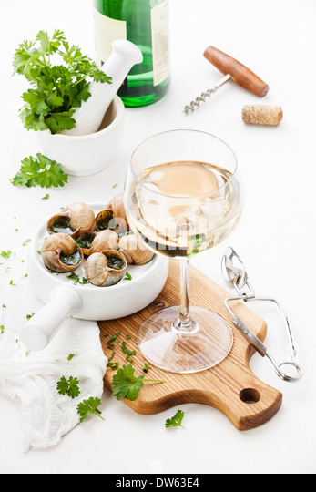 Baked snails with garlic butter sauce and wine - Stock Image