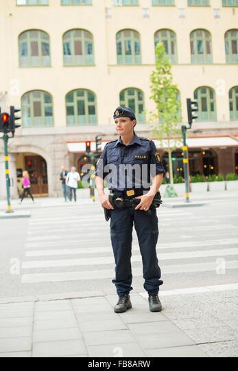 Sweden, Uppland, Stockholm, Policewoman looking away - Stock-Bilder