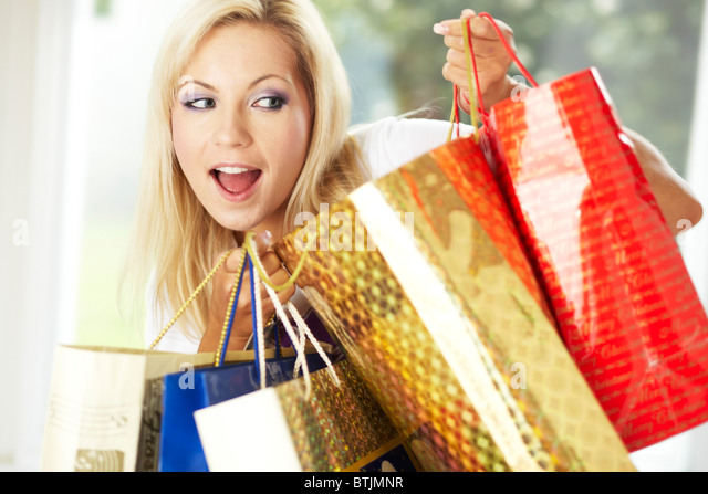 Girl with shopping bags - Stock Image