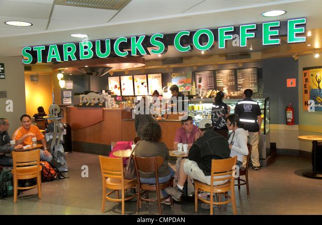 Peru Lima Jorge Chávez International Airport LIM aviation terminal concession Starbucks Coffee business chain - Stock Image