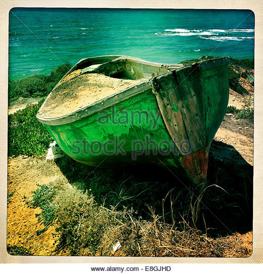 Old boat on coast line - Stock Image