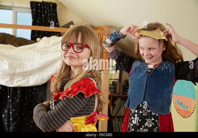 Two sisters playing dress up - Stock Image