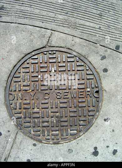 New York City Sewer Manhole Cover - Stock Image