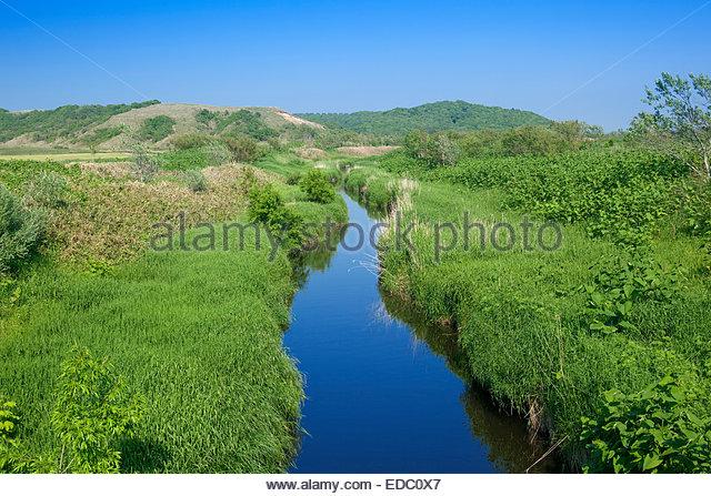 Abundant spring, brook, river, Sarobetsu uncultivated field, nature, Rishiri Rebun Sarobetsu national park, town, - Stock Image