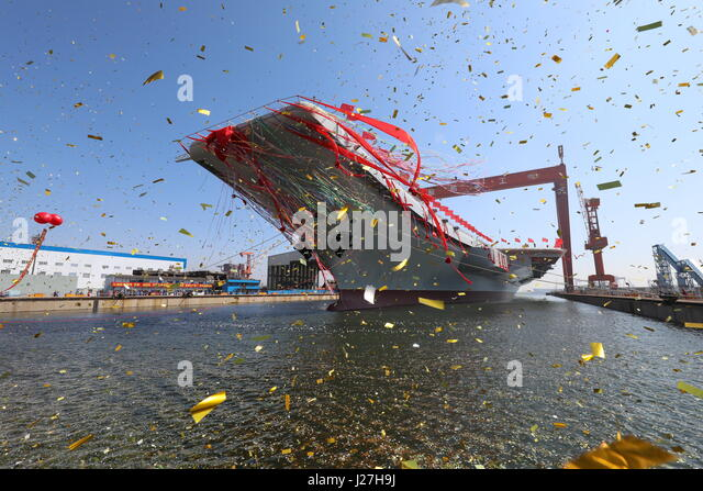 Dalian, China's Liaoning Province. 26th Apr, 2017. China's second aircraft carrier is transferred from dry - Stock Image