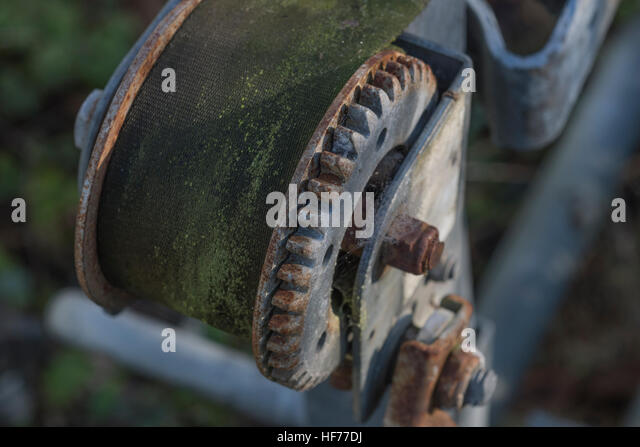Small windlass in a corner of an industrial estate. - Stock Image
