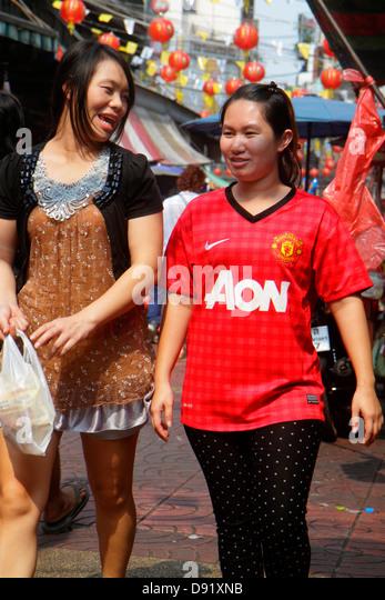 Thailand Bangkok Samphanthawong Chinatown Mangkon shopping market marketplace Asian woman - Stock Image