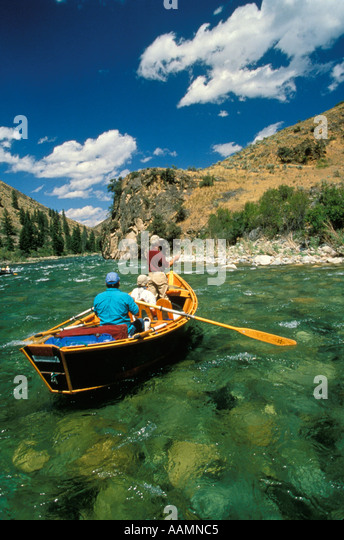 IDAHO Man Fly Fishing from drift boat Middle Fork of the Salmon River Frank Church Wilderness - Stock Image