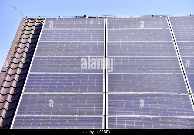 House roof with renewable energy solar and thermal photovoltaic panels - Stock Image