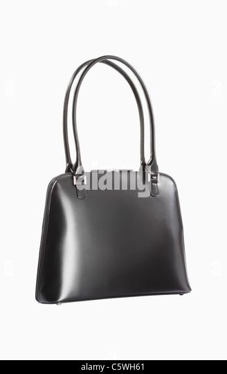Black leather purse against white background - Stock Image