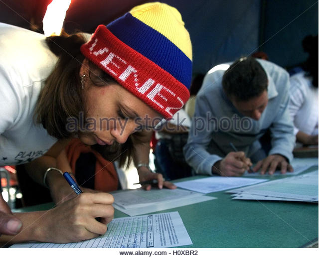 A Venezuelan woman signs a symbolic vote against Venezuela`s President  Hugo Chavez in Caracas, February 2, 2003. - Stock Image