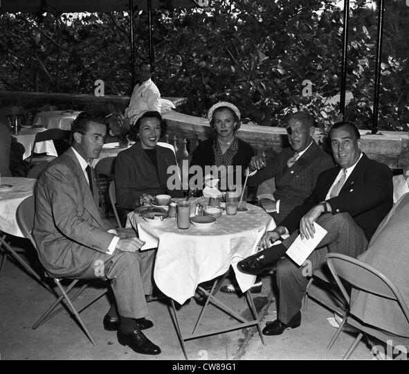 Robert Sweeney, Mrs. Dan Topping (Sonja Henie), Mrs. Winston Frost, Herbert Pulitzer and Dan Topping at Hialeah, - Stock Image