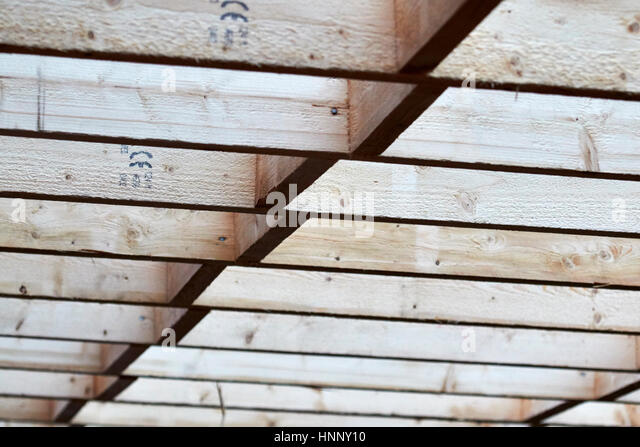 row of wooden roof rafter timbers in extension construction in the uk - Stock Image