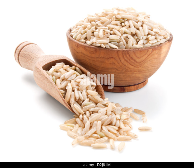 unpolished rice in a wooden bowl isolated on white background - Stock Image