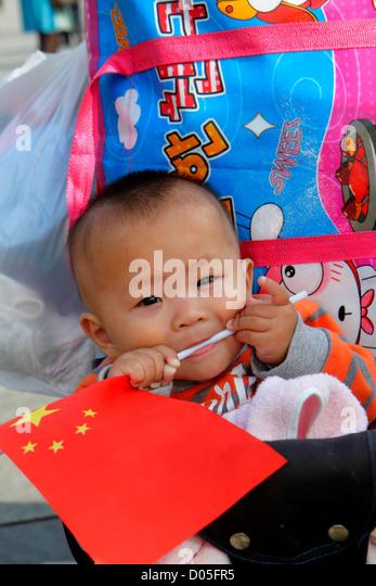 China Shanghai Huangpu District The Bund Zhongshan Road National Day Golden Week Asian boy baby flag teething - Stock Image