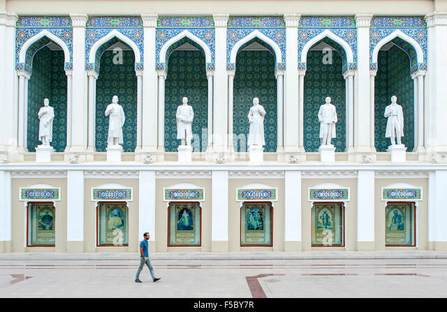 A man walking past the Nizami Museum of Azerbaijan Literature in Baku. - Stock Image