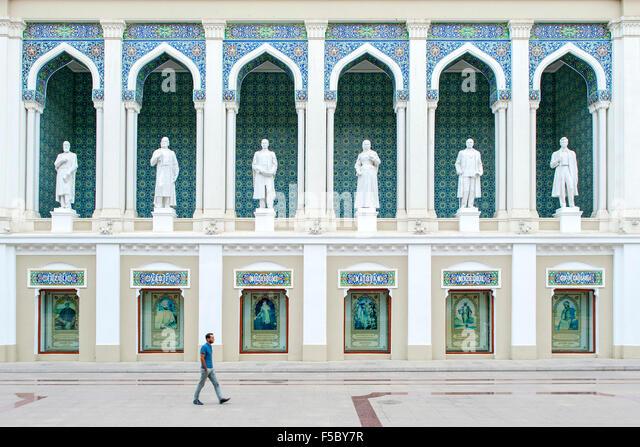 A man walking past the Nizami Museum of Azerbaijan Literature in Baku. - Stock Image