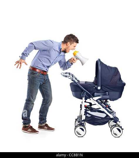 A mad father yelling to his baby laid down in a baby carriage - Stock Image
