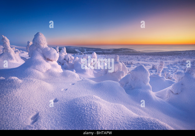 Winter snow landscape just after sunset, Karkonosze Mountains, Poland - Stock Image