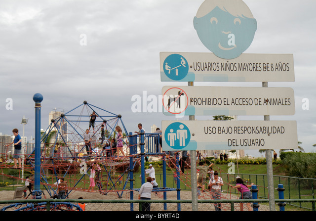 Panama City Panama Cinta Costera Pacific Ocean Coastal Beltway Bahia de Panama park playground boy girl parent child - Stock Image
