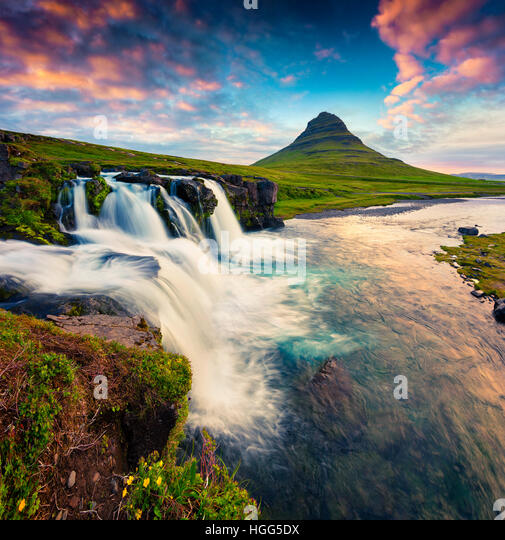 Summer sunset on famous Kirkjufellsfoss Waterfall and Kirkjufell mountain.Colorful scene on Snaefellsnes peninsula,Iceland. - Stock Image