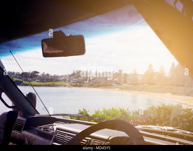 View of Bermagui, seen through windscreen of car, New South Wales, Australia - Stock Image