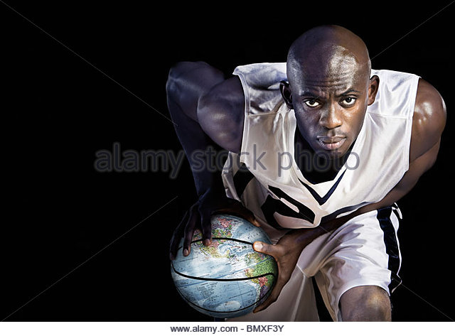 Basketball player with globe basketball - Stock Image