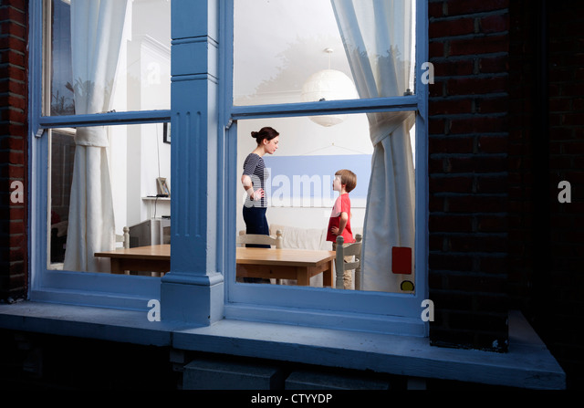 Mother and son viewed through window - Stock Image