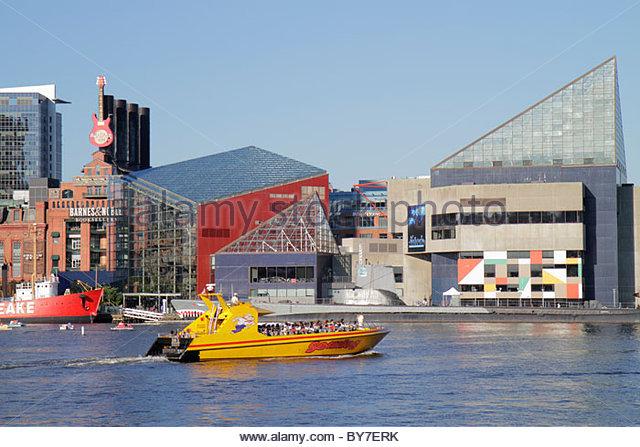 Maryland Baltimore Inner Harbor Harborplace Patapsco River waterfront National Aquarium skyline Seadog Speedboat - Stock Image