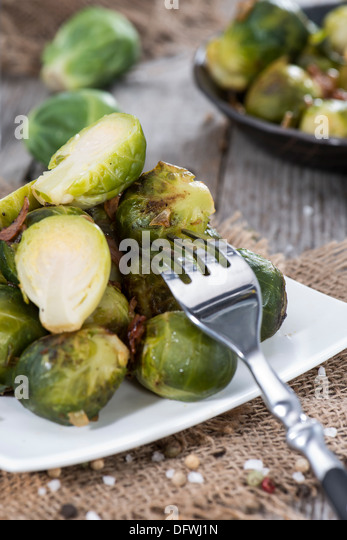 Portion of fried Brussel Sprouts with Ham and Onions - Stock Image